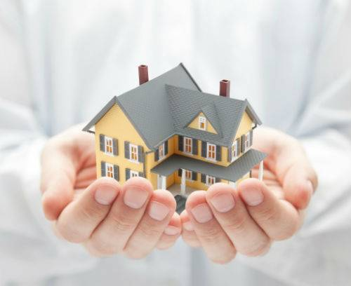 hand holding a two story home realestate legal document services